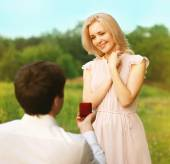 Romantic couple in love, ring, engagement, wedding - concept — Stock Photo