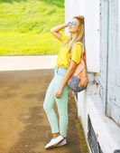 Modern pretty cool hipster girl enjoying summer posing in the ur — Stock Photo