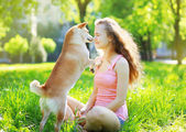 Dog and owner in park — Stock Photo