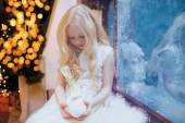 Christmas, winter, celebration concept - little girl near a fros — Stock Photo