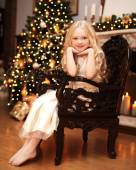Christmas and people concept - happy smiling little girl near ch — Stock Photo