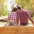 Pretty young modern couple in love resting outdoors in the park — Stock Photo #57095757