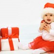 Christmas and people concept - happy smiling baby with gifts — Stock Photo #57096157