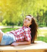 Young sensual pretty girl in country style outdoors — Stock Photo