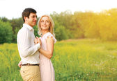 Lovely young couple in love outdoors in summer day — Stock Photo
