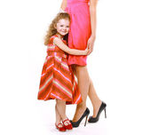 Beautiful mother and daughter in dress — Foto de Stock