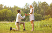 Man giving a ring woman, love, couple, date, wedding - concept — Stock Photo