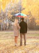 Autumn, love, relationships and people concept - young couple in — Stock fotografie