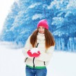 Winter and people concept - beautiful woman having fun in snowy  — Stock Photo #61889703