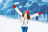 Winter and people concept - pretty woman rejoices winter weather — Stock Photo