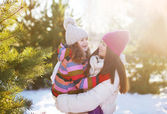 Winter and people concept - mother and child having fun playing  — 图库照片