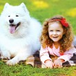 Portrait happy child and dog having fun outdoors — Stock Photo #63794467