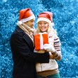 Christmas and people concept - happy man giving a box gift to a  — Stock Photo #63816639