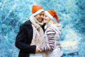 Christmas and people concept - happy young couple in love in win — Stock Photo