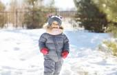 Child laughing and having fun in sunny winter day — Stock Photo