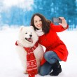 Winter, christmas, technology and people concept - happy woman a — Stock Photo #72271073