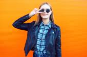 Fashion outdoor portrait of pretty cool girl in trendy rock styl — Stock Photo