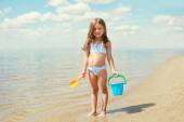Child with toys and having fun on the beach near sea in summer s — Stock Photo