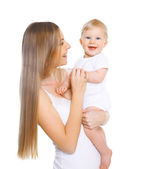 Portrait of happy young mother holding baby on hands — Stock Photo