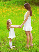 Mother and daughter walking and having fun together in summer da — Stock Photo