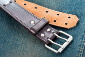 Leather belt of vintage blue jeans  — Foto de Stock
