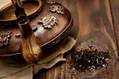 Antique iron hot tea pot on dark wooden background — Stockfoto