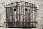 Old wooden door with damaged wall — Foto de Stock