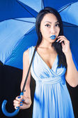 Charming woman in a blue dress with a stylish umbrella — Stock Photo