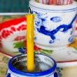 Candle in pot with joss stick — Stock Photo #59016045