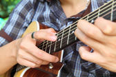 Tapping technic to fingerboard of guitar — Stock Photo