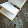 Notepad with pencil on wooden table (vintage color toned image) — Stock Photo #58649027