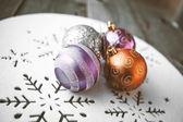 Christmas decoration on wooden table (vintage color toned image) — Fotografia Stock