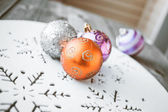 Christmas decoration on wooden table (vintage color toned image) — Stock Photo