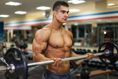 Bodybuilder with barbell — Stock Photo