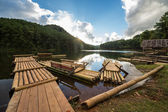 Wooden raft with the sun — Stock Photo