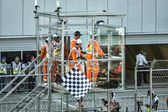 Checkered finish flag over the Speedway Grand Prix. — Stock Photo
