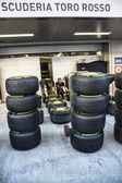 Mechanics team scuderia toro rosso produce sets of rubber to the — Stock Photo