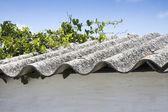 Dangerous asbestos roof — Stock Photo