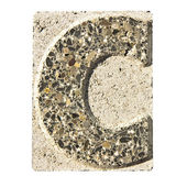 Letter C carved in a concrete block — Stockfoto