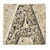Letter A carved in a concrete block — Stock Photo