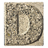 Letter E carved in a concrete block — ストック写真