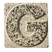Letter G carved in a concrete block — Foto Stock