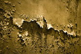 Degraded plaster in golden color - Toned image — Stock Photo