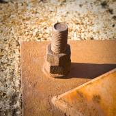 Old rusty bolt with iron plate — Stock Photo
