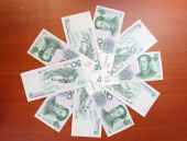 Chinese yuans by fifty (50) denomination are on a table by ring — Stock Photo