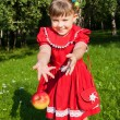 Laughing girl throwing up redapples — Stock Photo #52109409