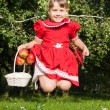 Laughing girl throwing up redapples — Stock Photo #52109607