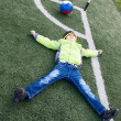 Little boy soccer ball lying on  grass — Stock Photo #52965197