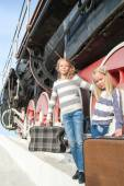 Girls waiting for landing on the platform in  vintage train — Stock Photo