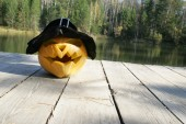 Pumpkin in autumn leaves — Stock Photo